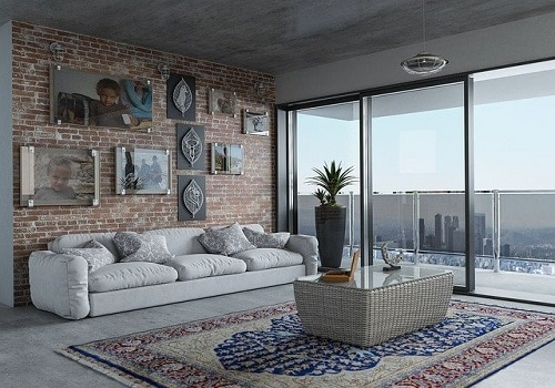 pacious living room with glass balcony doors and a view of the city