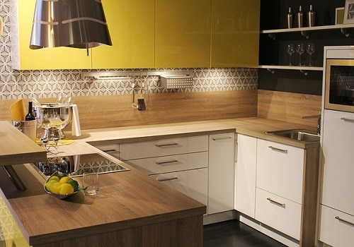 A kitchen with clean, de-cluttered countertops and adequate lighting