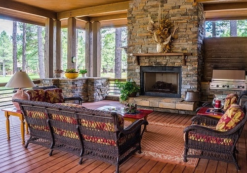 A view of a cozy living area with a fireplace as the focal point