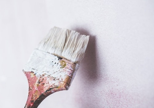 Brush on the wall with white color