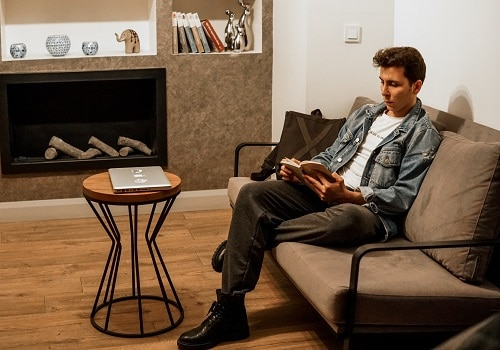 A man reading in a living room