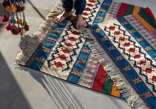 A person standing on a rug symbolizing ways to update your rented home without risking your deposit.